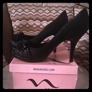 Nina brand peep toe pumps.